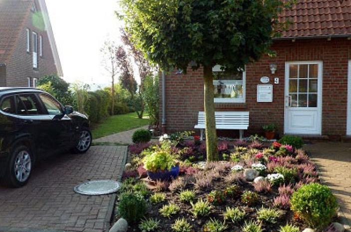 Harlesiel Ferienhaus und Parkplatz